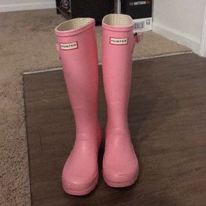 Tall, light pink Hunter boots